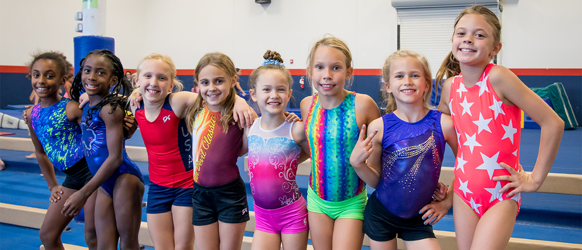group of young girl gymnasts on balance beam